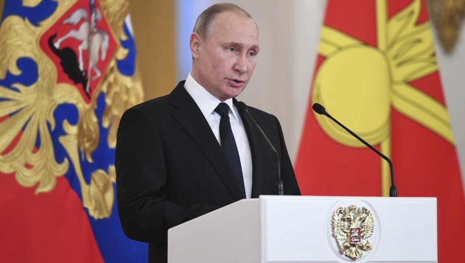 Russian President Vladimir Putin delivers a speech during an award ceremony in the Kremlin, in Moscow, on December 28.