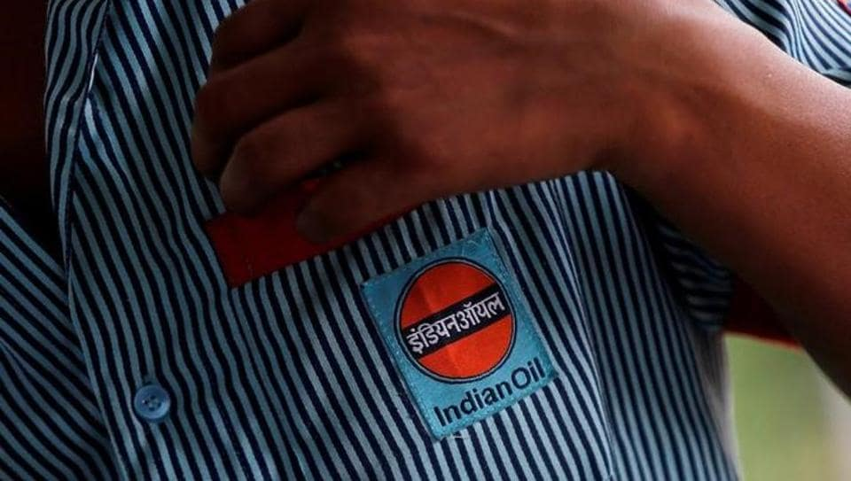 A logo of Indian Oil is seen on the shirt of an employee at a fuel station in New Delhi, India August 29, 2016.