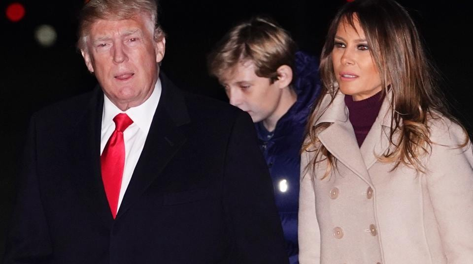 US president Donald Trump, First Lady Melania Trump and son Barron at the White House in Washington, DC on January 1, 2018.