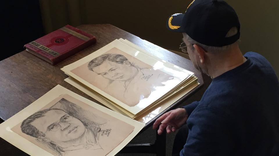 "World War II veteran Wilfred ""Spike"" Mailloux looks through a series of sketches of US Army 27th Infantry Division soldiers while visiting the New York State Military Museum and Veterans Research Center in Saratoga Springs, NY."