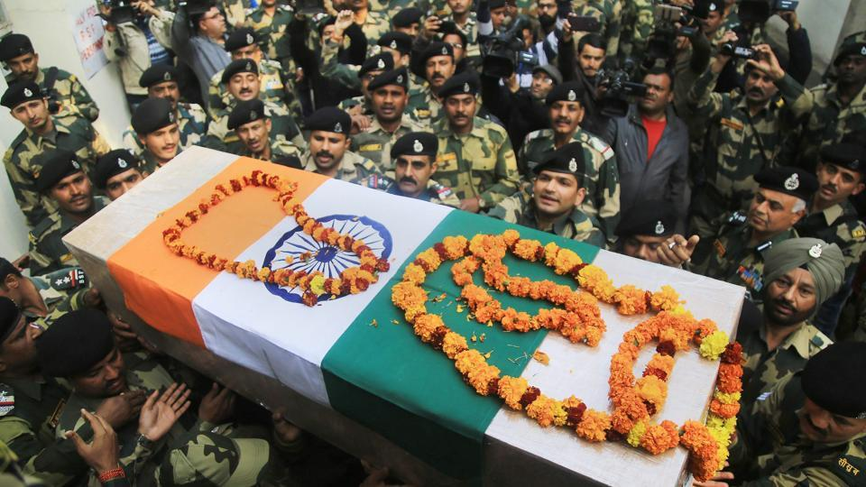 Border Security Force(BSF) officers carry the coffin of Head Constable Radha Pada Hazra at a wreath-laying ceremony in Samba on Thursday.