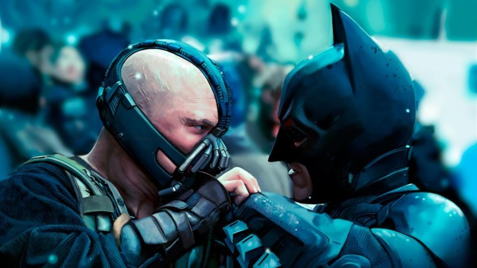 Tom Hardy as Bane and Christian Bale as Batman in The Dark Knight Rises.