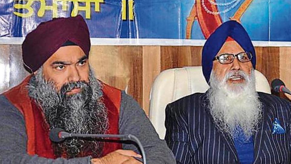 Former chief of Khalsa Diwan Charanjit Singh Chadha (R) with his son Inderpreet Singh.