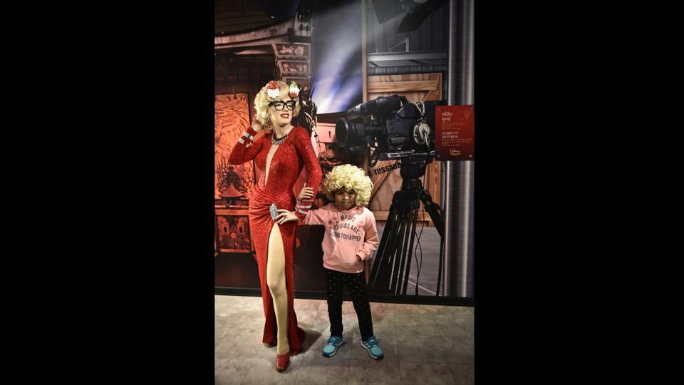 "A child poses with a wax figure of Marilyn Monroe at Madame Tussauds. A total of 50 statues (60 per cent of the display is Indian content) stand at various spots in this ""attraction centre"". An obvious miss seems to be the reigning superstar of Bollywood – Shah Rukh Khan. Aamir Khan is not here either. India's first Prime Minister, Jawaharlal Nehru, is another absence.  (Sanchit Khanna / HT Photo)"