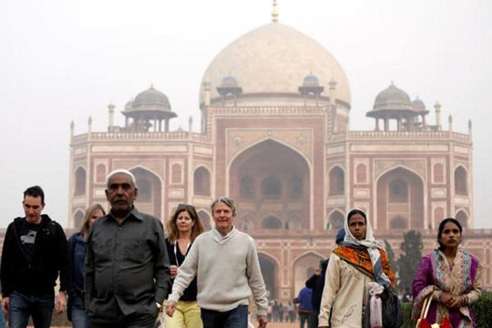 Tourists at  Humayun's Tomb. Between 75%  and 80% of the money spent on the conservation of the tomb was paid to craftsmen.