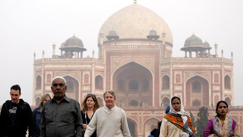 Domestic and foreign tourists walk in front of Humayun's Tomb, in New Delhi, India, January 1, 2018.