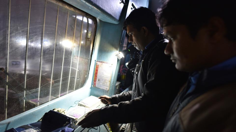 "A locomotive driver demonstrates the use of the Fog Safe device on January 4, 2018. ""On clear days, we run the trains at the sanctioned speed, which is around 100 kmph. When it is foggy, we do not go over 30-35 kmph,"" said the pilot, illustrating how trains run at almost less than half their regular speeds, causing delays. (Sanchit Khanna / HT Photo)"
