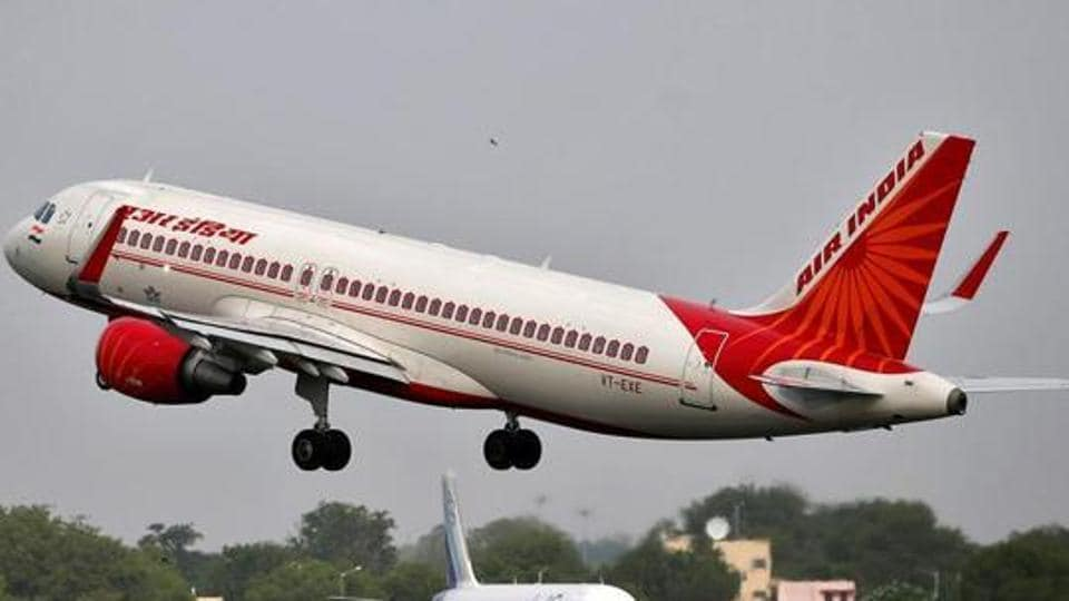 An Air India aircraft takes off as an IndiGo Airlines aircraft waits for clearance at the Sardar Vallabhbhai Patel International Airport in Ahmedabad.