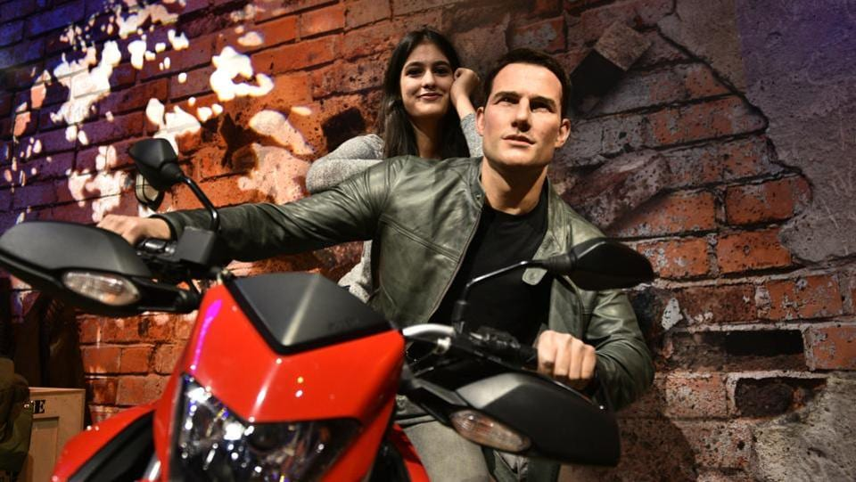 A girl poses with a wax figure of Tom Cruise at Madame Tussauds in New Delhi. The internationally famous wax museum, has opened its first Indian centre in Delhi. Named after the French wax sculptor Marie Tussauds who used to assist a physician skilled in wax modelling, the wax museum in New Delhi is housed in the refurbished Regal Theatre, founded in 1932. (Sanchit Khanna / HT Photo)