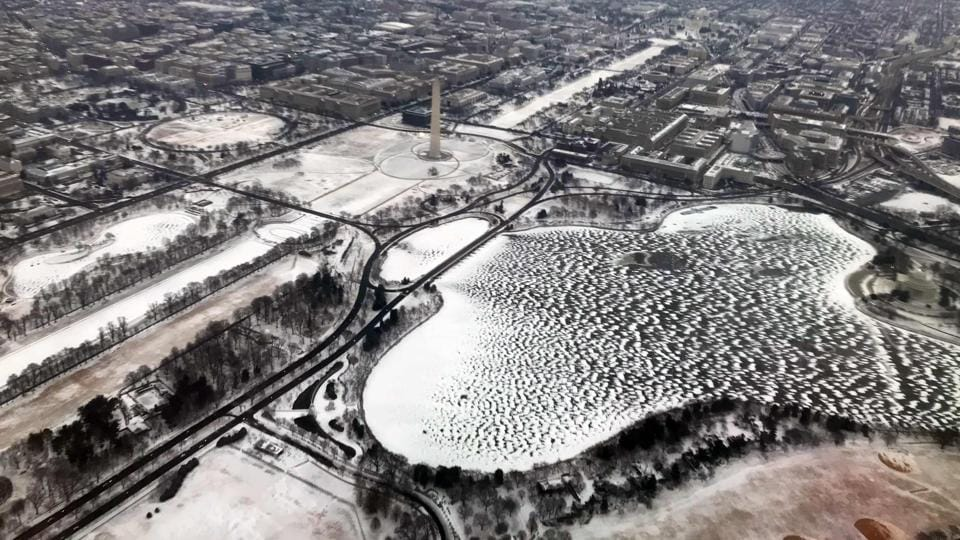 This aerial view shows snow covered Washington Memorial Monument. Millions of Americans along the East Coast face potential power outages in bitterly cold sub-freezing temperatures. Almost 80,000 homes and businesses in the Northeast and Southeast, were without power. (Daniel Slim / AFP)