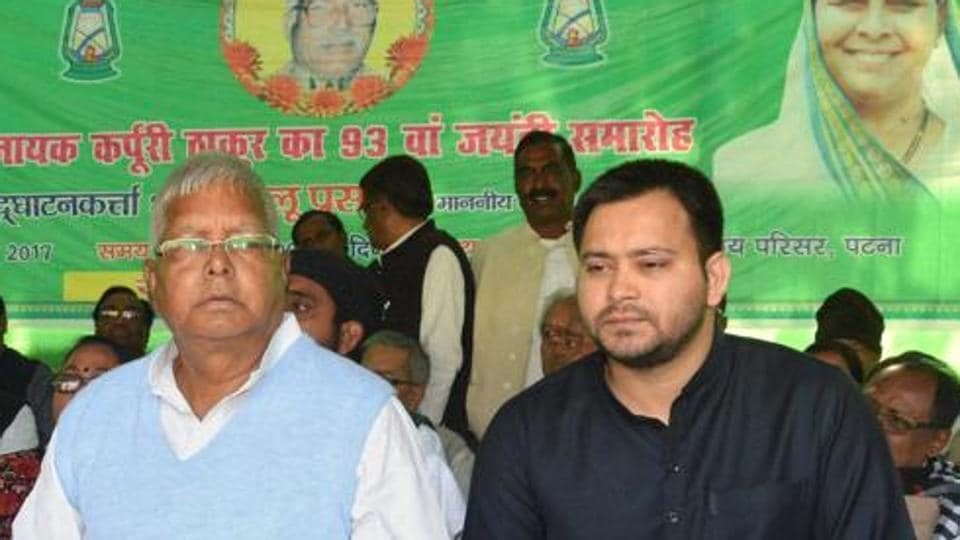 RJD chief Lalu Prasad Yadav with son Tejashwi Yadav during the 93rd birth anniversary celebrations of Jannayak Karpoori Thakur at party office in Patna.