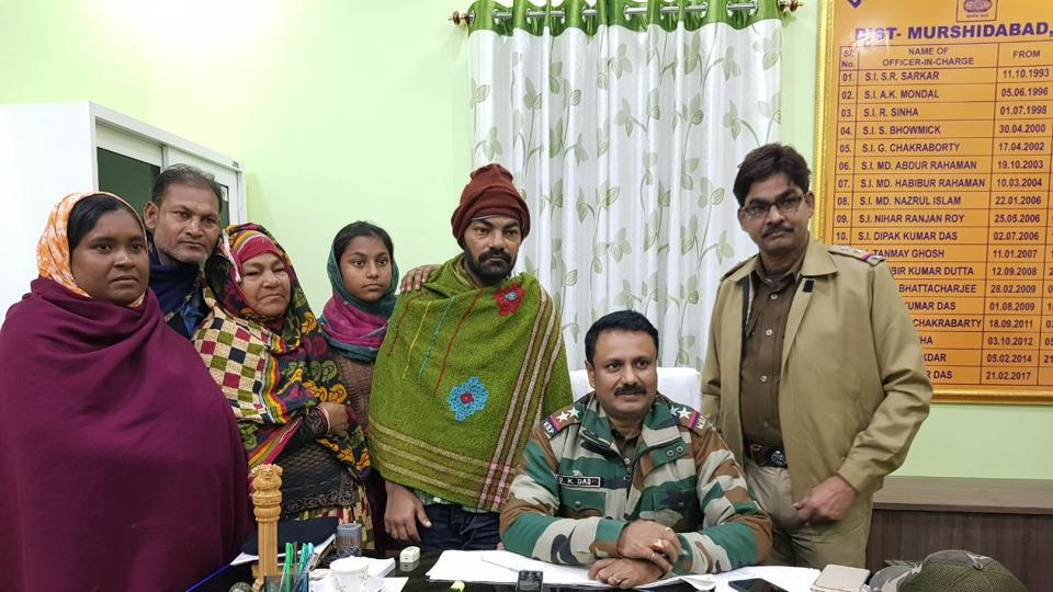 Bhagabangola police station officer-in-charge Uptal Das (seated) with Mohammad Jafar (in shawl) and his family members.