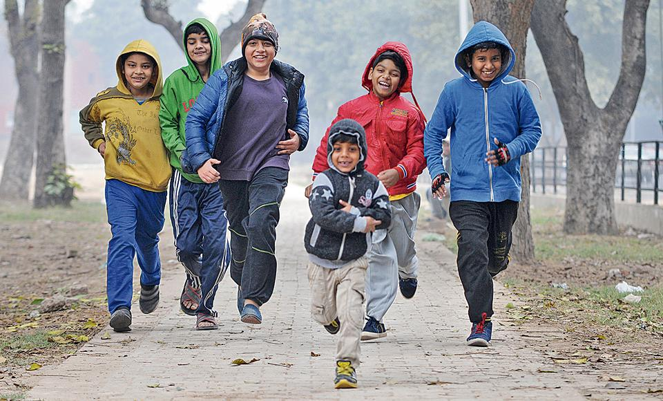 Children enjoying the cold and foggy weather in Chandigarh on Saturday.