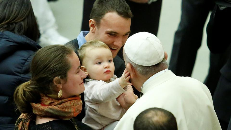 A baby caresses Pope Francis during his Wednesday general audience in Paul VI hall on January 03, 2018 at the Vatican. (Remo Casilli / REUTERS)