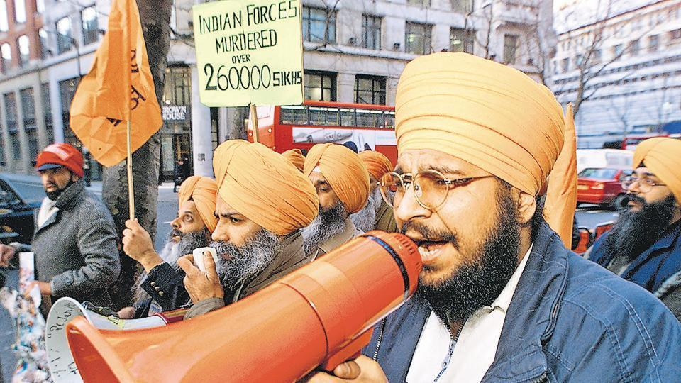 Sikh demonstrators shout slogans during a protest outside India House in London.