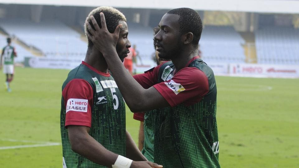 Dipanda Dicka and an own goal from Aizawl FC's Masih Saighani gave Mohun Bagan a victory after four games in the I-League.