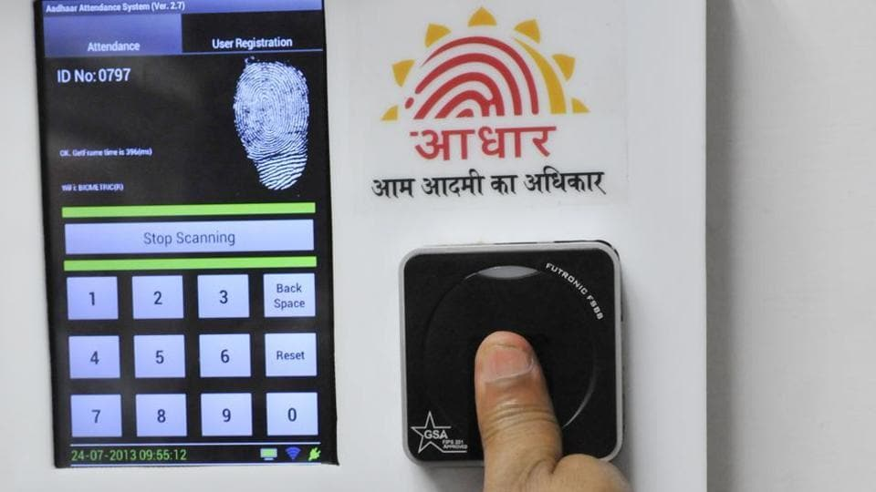 Employees mark their attendance through an Aadhaar-based biometric system in the Planning Commission.