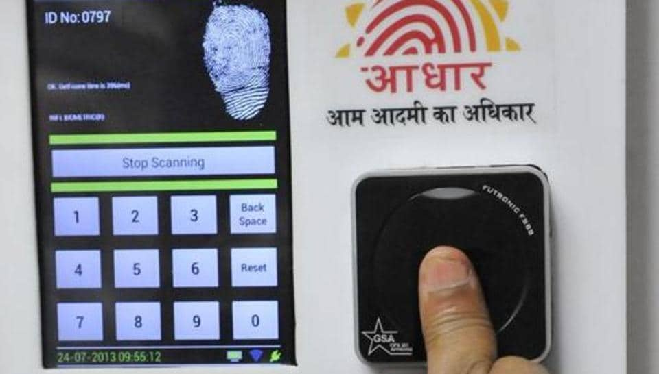 Employees mark their attendance through Aadhaar-based biometric system at the Planning Commission.