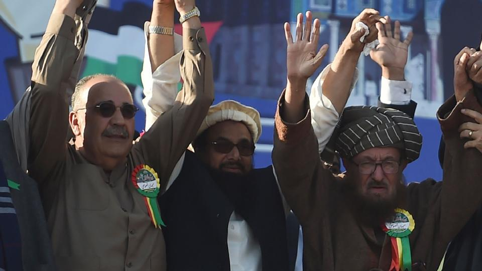 (From right) Difa-e-Pakistan Council's Maulana Sami ul Haq, JuD chief Hafiz Saeed, Palestinian ambassador to Pakistan Walid Abu Ali during an anti-US and anti-Israel rally in Rawalpindi on December 29, 2017.