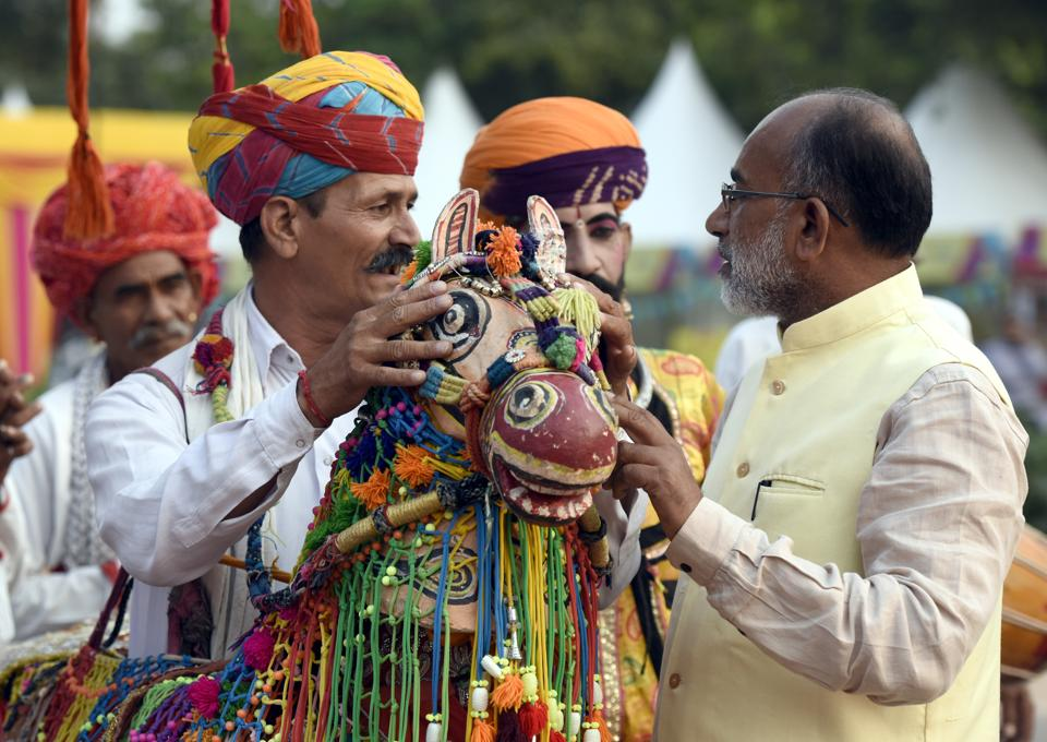 Union tourism minister KJ Alphons talks with an artist at a programme in New Delhi on October  23, 2017.