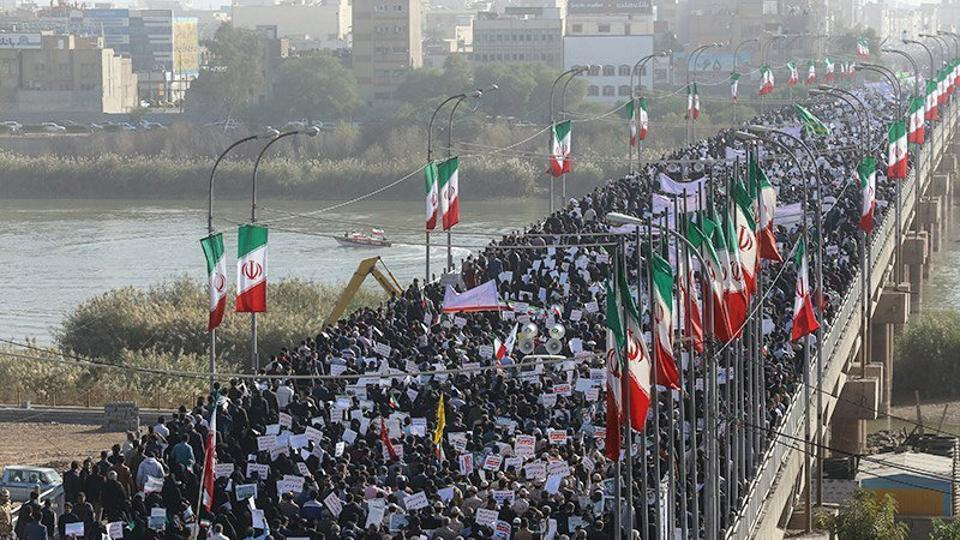 People take part in pro-government rallies in Iran on January 3, 2018.