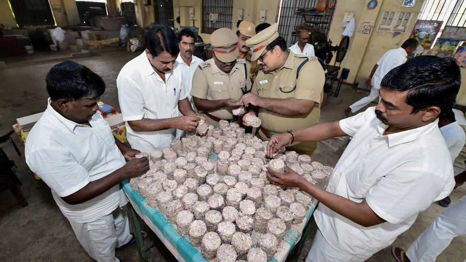 Prison officials and jail inmates arrange bundles of compacted notes, supplied by Reserve Bank of India, for making stationary at Puzhal Central Prison. According to a senior official, the stationery made here is used by state government departments and their agencies. (R Senthil Kumar / PTI)