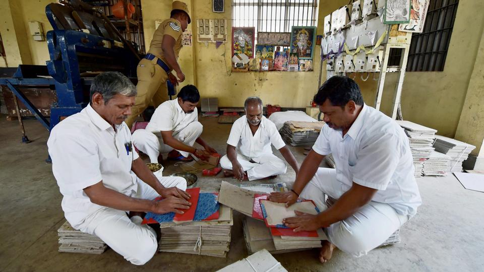 "After pasting the cover inmates tag them with ""Urgent"" and ""Ordinary"" markings. Though six other jails in Tamil Nadu including Vellore, Salem and Madurai make such holders, Puzhal is the only centre to make them out of old currency. Approximately 1.5 lakh file-pads are produced every month in Tamil Nadu. (R Senthil Kumar / PTI)"
