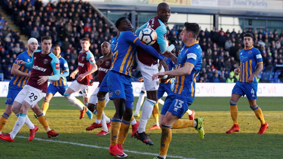 West Ham United's Angelo Ogbonna vie for the ball with Shrewsbury Town's Aristote Nsiala during their FACup match on Sunday.