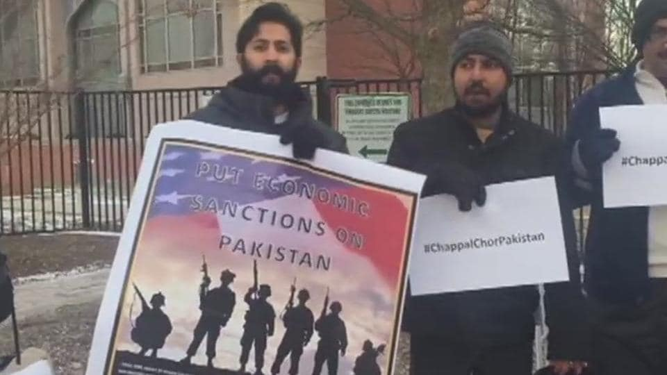 People protest outside the Pakistani embassy in Washington DC.