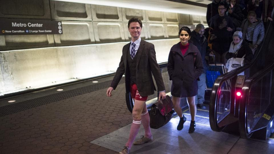 Participants in the No Pants Subway Ride DC, walk through a Metro station in Washington, DC. The No Pants Subway Ride was started in 2002 by Improv Everywhere in New York. (Andrew caballero-Reynolds / AFP)