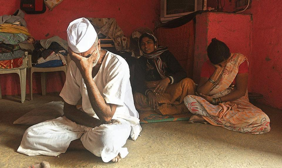 Babaji Phatangale (left) mourns the death of his son Rahul Phatangale, who was killed during the Bhima Koregaon violence.