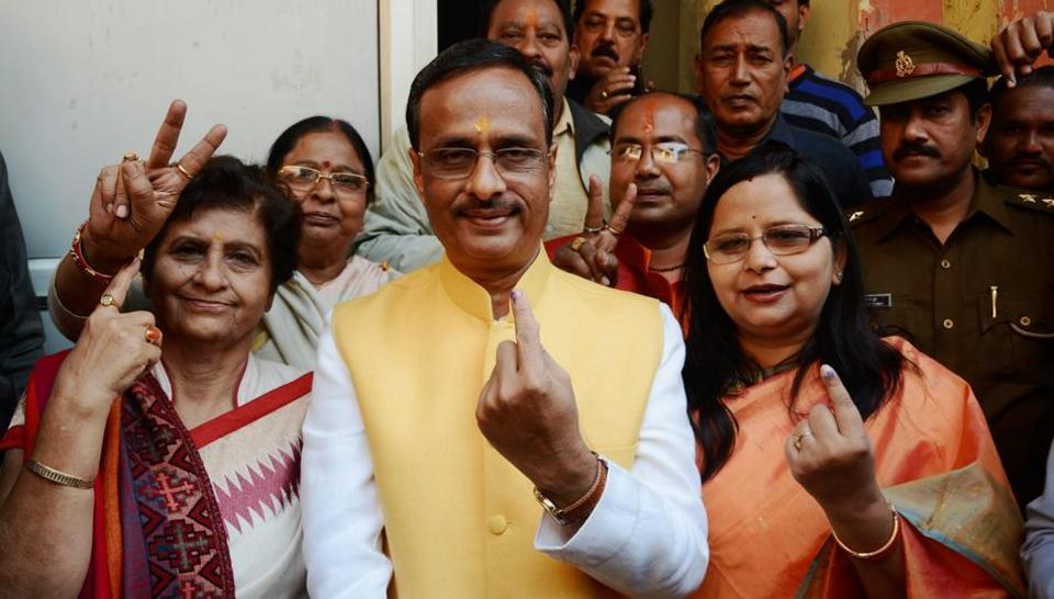 Deputy Chief Minister Dinesh Sharma with his wife right) and BJP mayor candidate Sanyukta Bhatia (left) after casting their votes for civic polls in Lucknow on November 26, 2017.