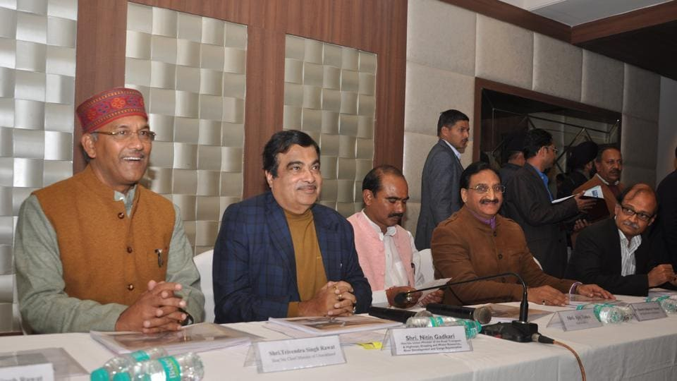 Union road transport minister Nitin Gadkari (second from left) and chief minister TS Rawat (left) during a function in the state capital.