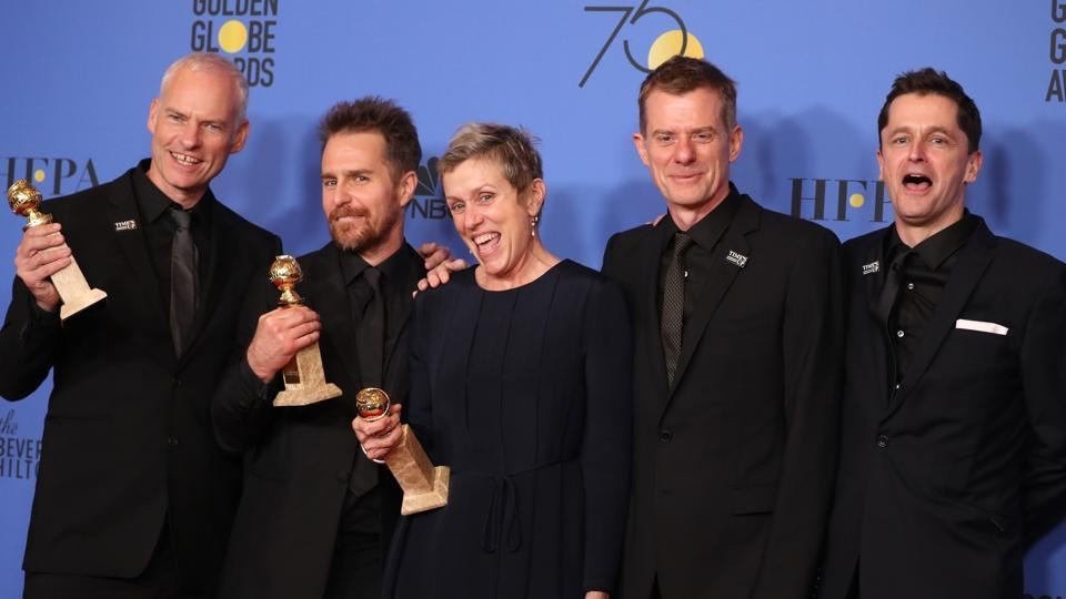 Martin McDonagh (L) poses backstage with cast and producers of Three Billboards Outside Ebbing, Missouri.