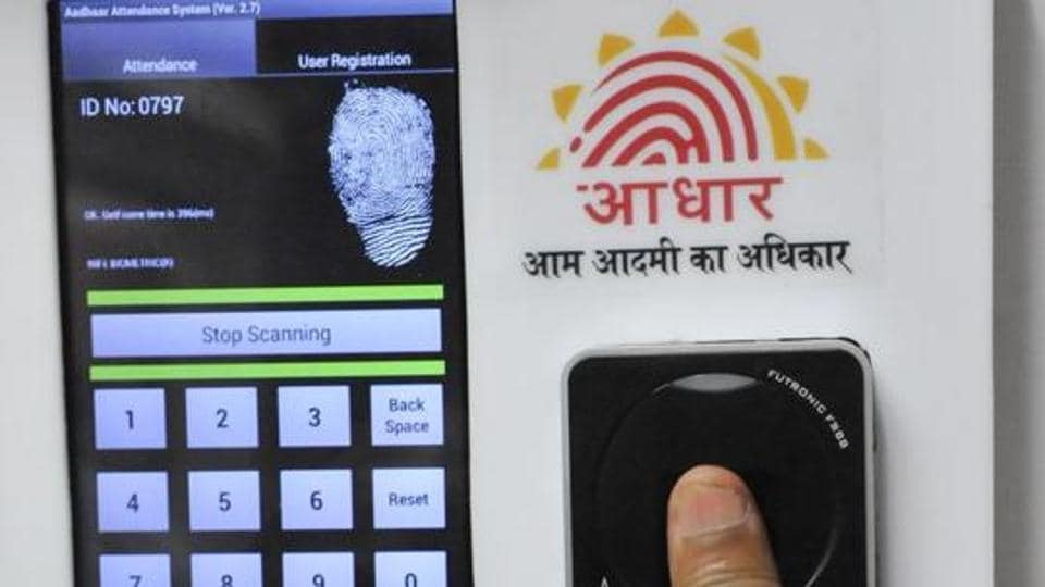 Employees mark their attendance through Aadhaar-based biometric system in the Planning Commission.
