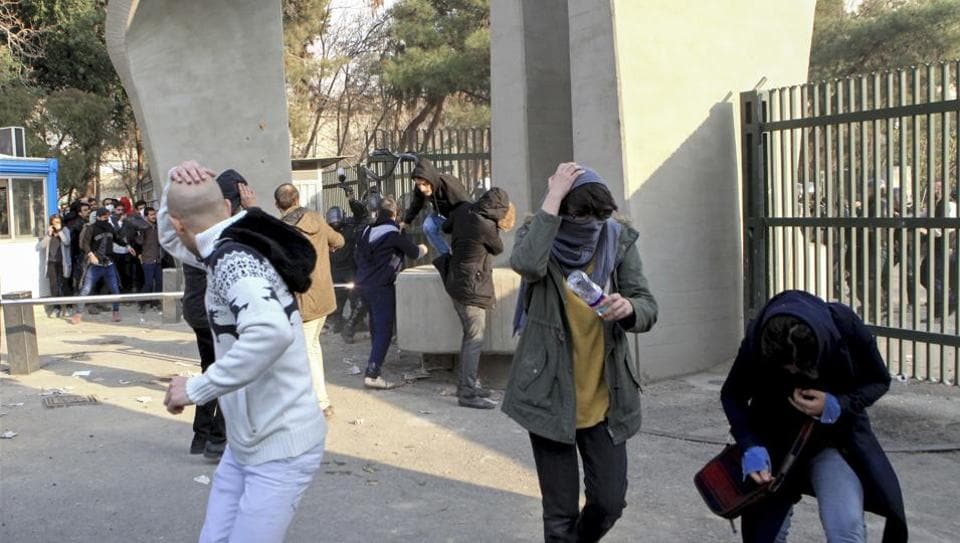 University students run away from stones thrown by the police during an anti-government protest inside Tehran University. Demonstrations, the largest seen in Iran since its disputed 2009 presidential election, have brought six days of unrest across the country and resulted in over 20 deaths.