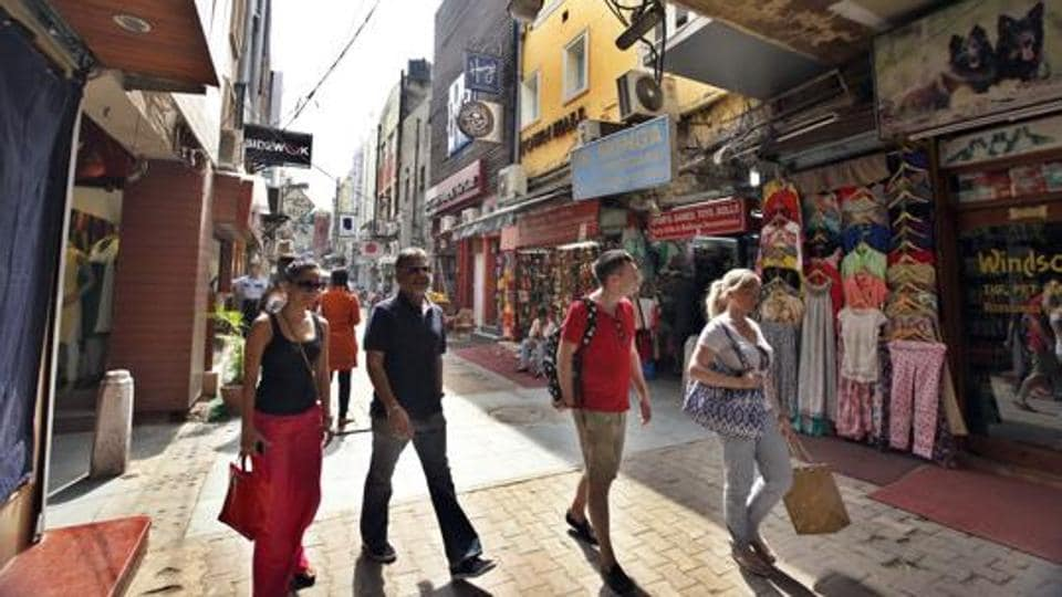 People walk through Khan market, located in central New Delhi.