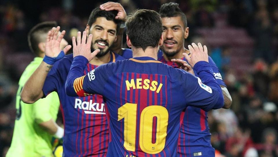 Barcelona's Paulinho celebrates scoring their third goal against Levante with Lionel Messi and Luis Suarez at Camp Nou on Sunday.