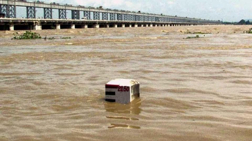 A view of the swollen Mahanadi river flowing near Mundali in Cuttack.