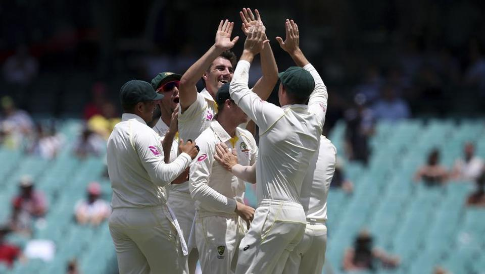 Australia's Pat Cummins, center, celebrates with teammates after dismissing England's Stuart Broad during the last day of their Ashes Test in Sydney on Monday. Australia won the Test by an innings and 123 runs to complete a 4-0 series win.