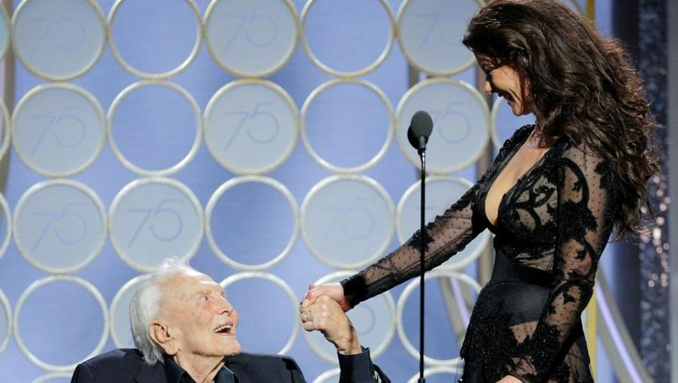Presenters Kirk Douglas and Catherine Zeta Jones at the 75th Golden Globe Awards in Beverly Hills, California.