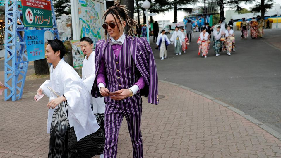 "The men usually wear either Western-style attire with jewellery or a traditional men's kimono with hakama. Some opt for the kind of plain business suits they will wear as ""salarymen"" in the future. (Kim Kyung-Hoon / REUTERS)"