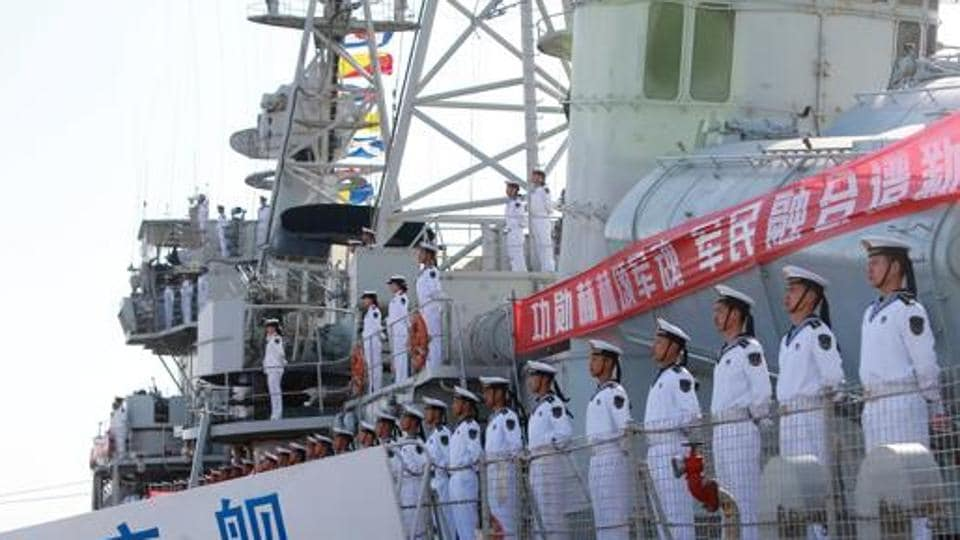 Chinese People's Liberation Army navy soldiers stand on a decommissioned destroyer in an aircraft carrier theme park on China's Navy Day in Tianjin last April.