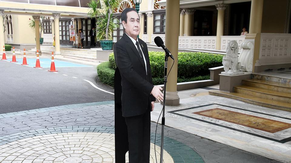 A cardboard cut-out of Thailand's Prime Minster Prayuth Chan-ocha is seen next to a microphone after a news conference at government house in Bangkok, Thailand.