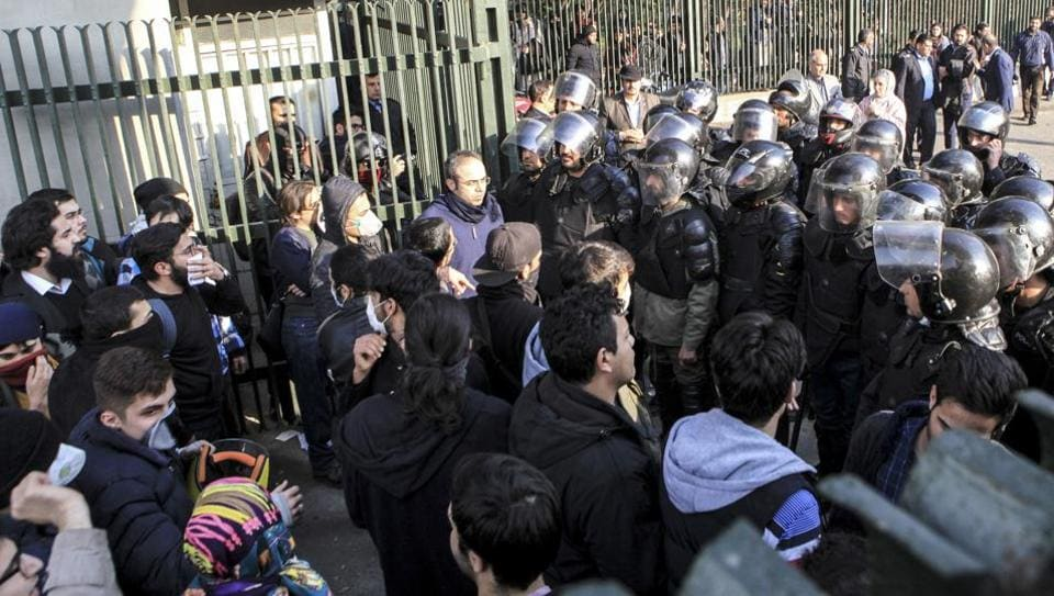In this Dec.30, 2017 file photo, anti-riot Iranian police prevent university students to join other protesters over Iran weak economy, in Tehran, Iran.