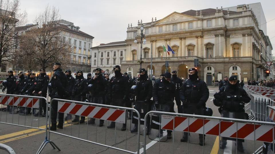 Police officers patrol the area in front of La Scala opera house in Milan, Italy.