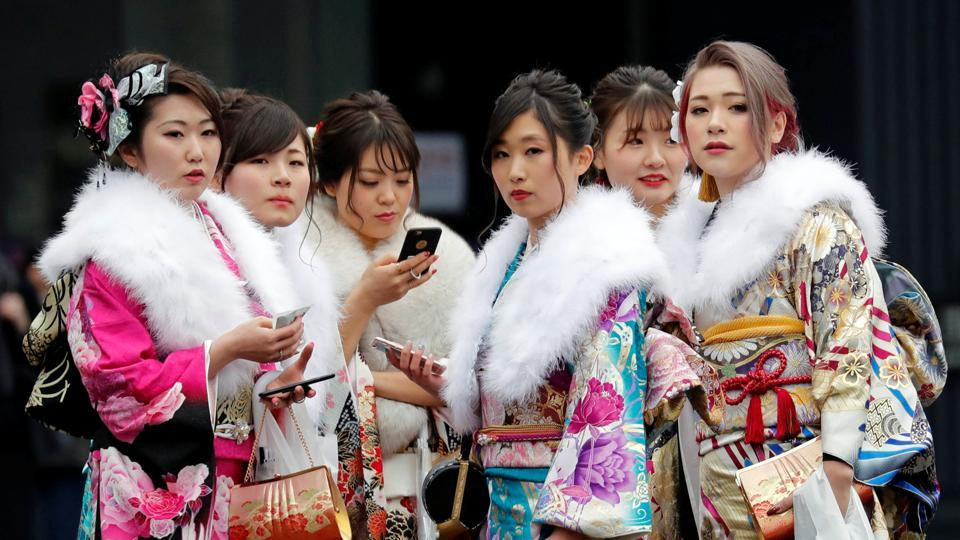 Japanese women attend their Coming of Age Day celebration ceremony at an amusement park in Tokyo, Japan on January 8, 2018. Dazzling in colourful kimonos and wafting clouds of hairspray in their wake, thousands of young Japanese women marked their entry into official adulthood. (Kim Kyung-Hoon / REUTERS)