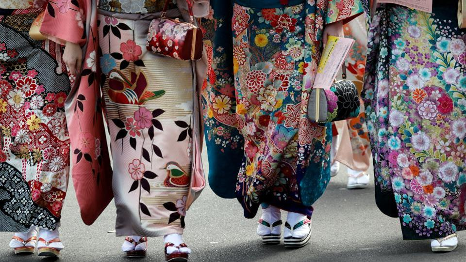 Nearly all young women wear elaborate kimonos or furisode, a long-sleeved kimono for unmarried young women, on this day. Kimono rentals also exist specific to this occasion since the actual cost of such attire can run into thousands of dollars.  (Kim Kyung-Hoon / REUTERS)