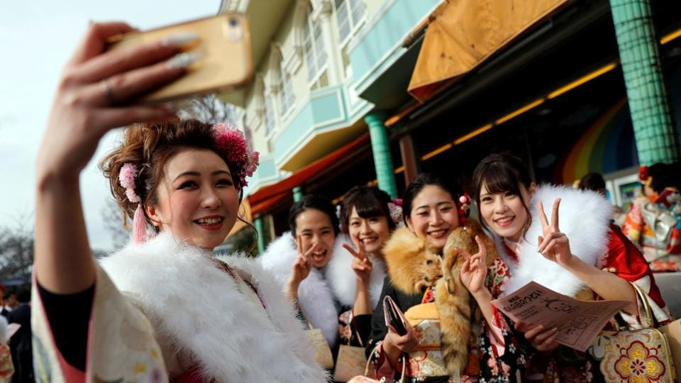 Revellers pose in kimonos as they attend their Coming of Age Day celebrations. The ceremonies eventually lead into more informal celebrations with photoshoots, heading out with friends to restaurants, amusement parks and bars for legal drinking. (Kim Kyung-Hoon / REUTERS)