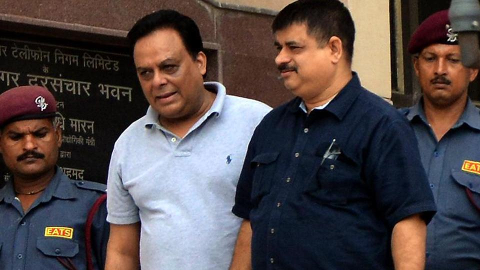 Meat exporter Moin Qureshi with an Enforcement Directorate officer in connection with Rs 200 crore money laundering case in New Delhi's Patiala House court last August.